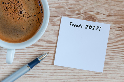 Trends 2017 written at notepad on table workplace near cup of morning coffee. New year business and fashion trendings, innovation