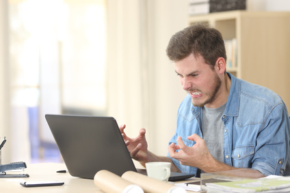 Entrepreneur angry and furious with laptop