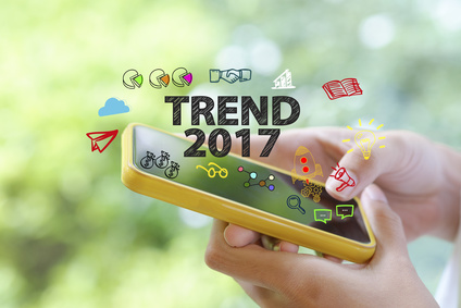 hand holding a smartphone with TREND 2017  concept , business co